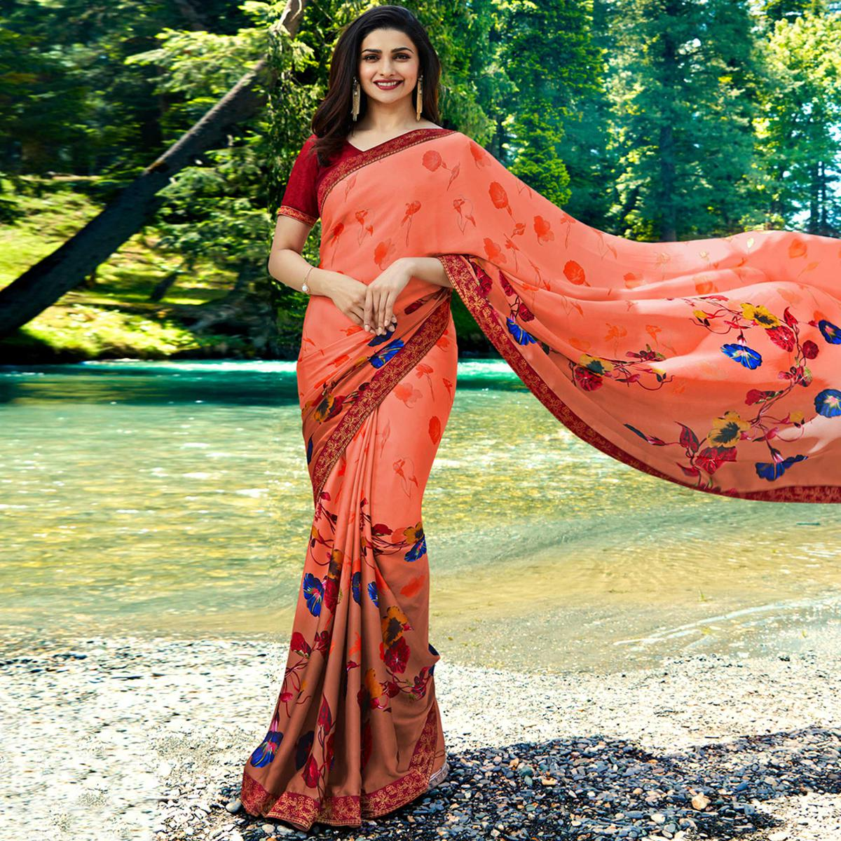 Sensational Orange Colored Casual Wear Printed Georgette Saree