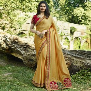 Gleaming Yellow Colored Partywear Embroidered Art Silk Saree