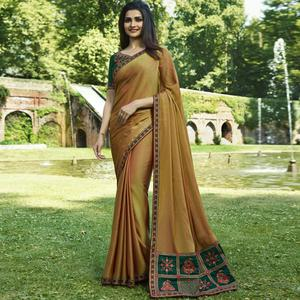Surpassing Yellow Colored Partywear Embroidered Silk Saree