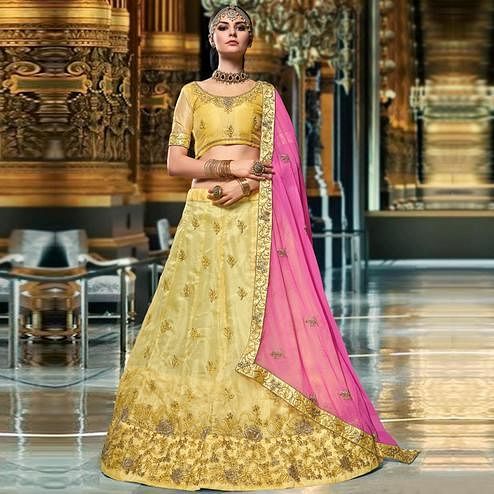 Prominent Light Yellow Colored Wedding Wear Embroidered Organza Lehenga Choli