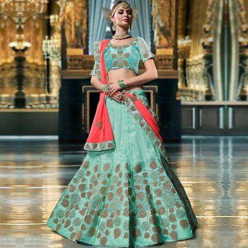 Capricious Aqua Blue Colored Wedding Wear Embroidered Organza Lehenga Choli