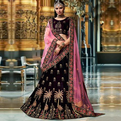 Glowing Dark Purple Colored Wedding Wear Embroidered Heavy Velvet Lehenga Choli