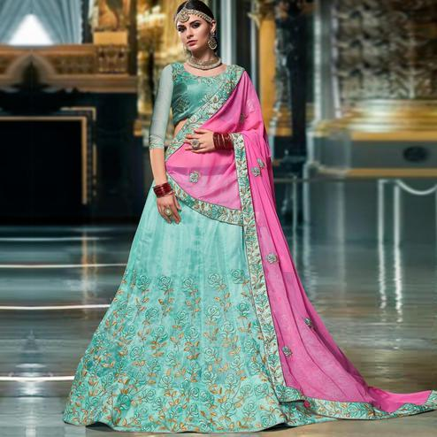 Hypnotic Aqua Blue Colored Wedding Wear Embroidered Organza Lehenga Choli