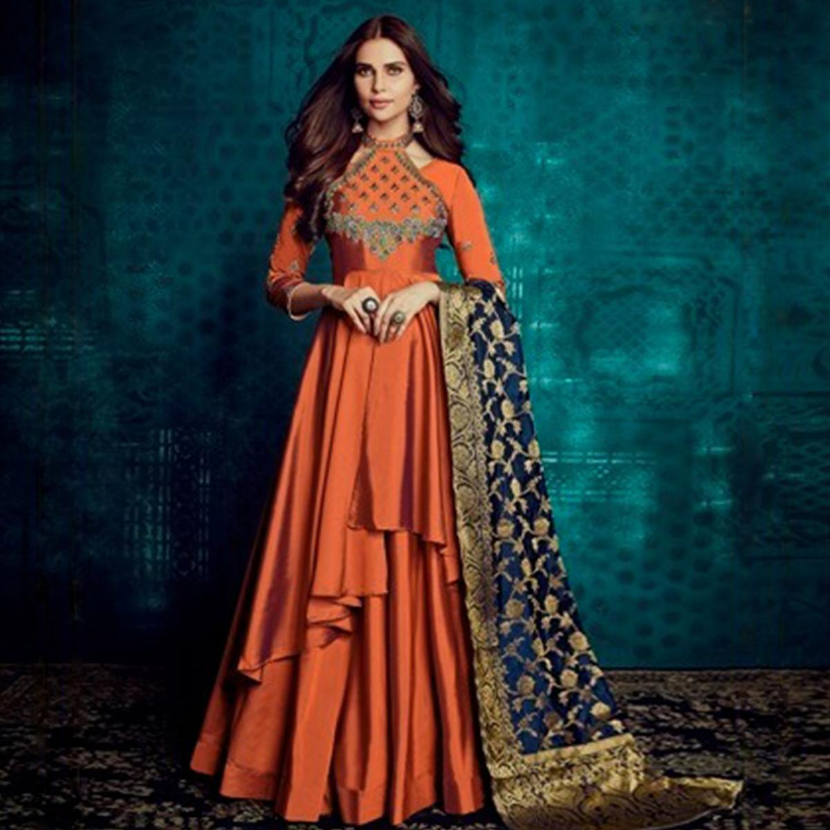 Staring Orange Colored Party Wear Embroidered Tapetta Silk Gown