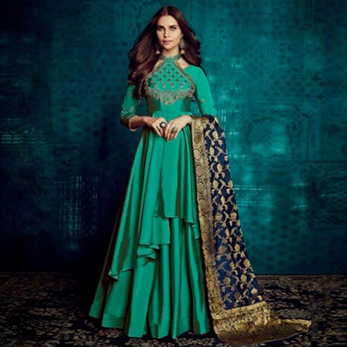 Pleasance Turquoise Green Colored Party Wear Embroidered Tapetta Silk Gown