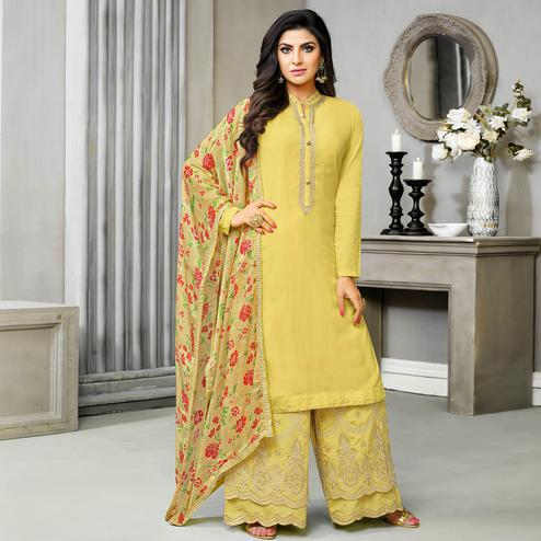 Attractive Yellow Colored Partywear Embroidered Cotton Silk Palazzo Suit