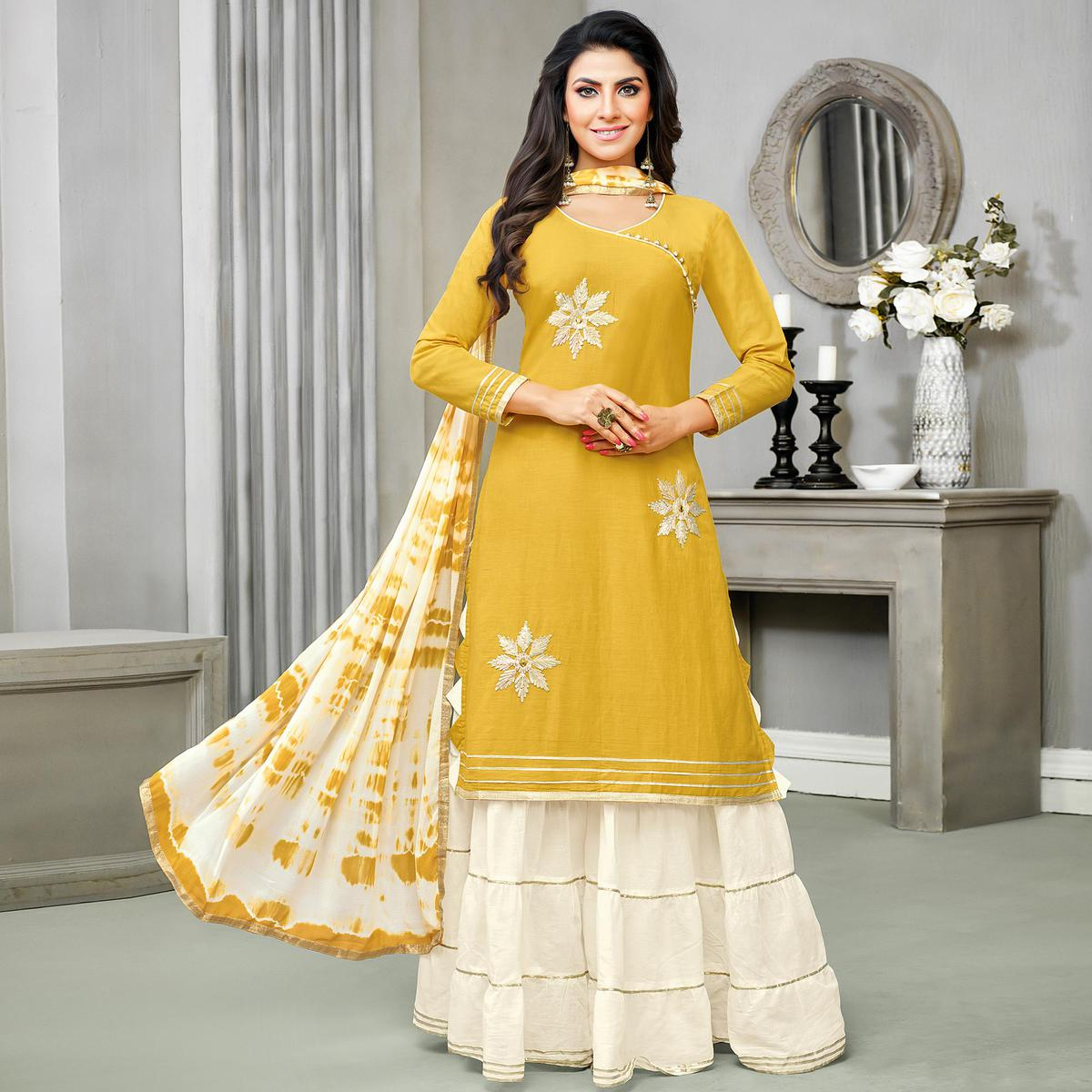 Glowing Yellow Colored Partywear Embroidered Cotton Palazzo Suit