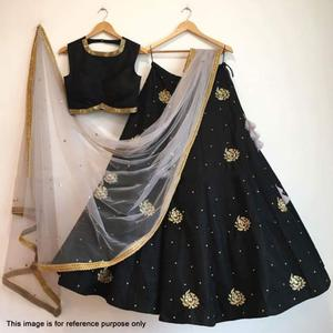 Stunning Black Colored Partywear Embroidered Tapeta Silk Lehenga Choli