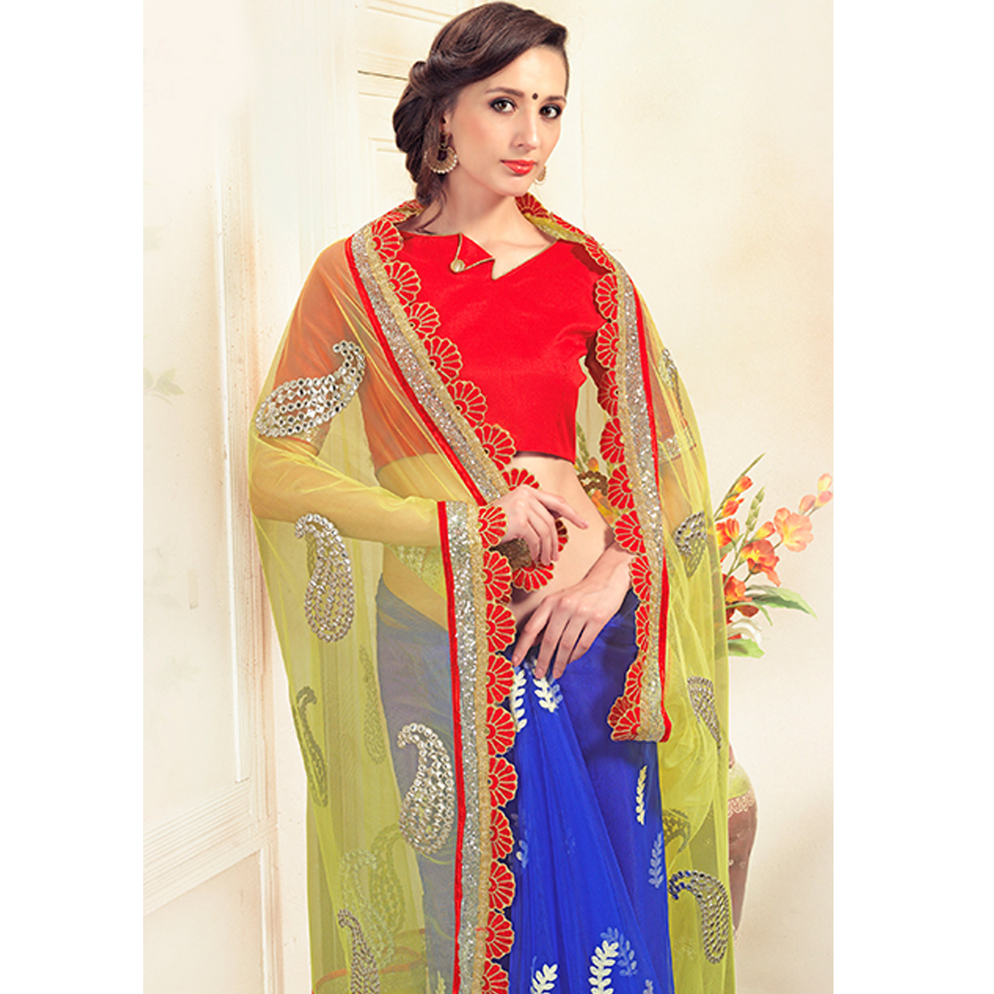 Flattering Yellow-Blue Colored Party Wear Embroidered Net Saree