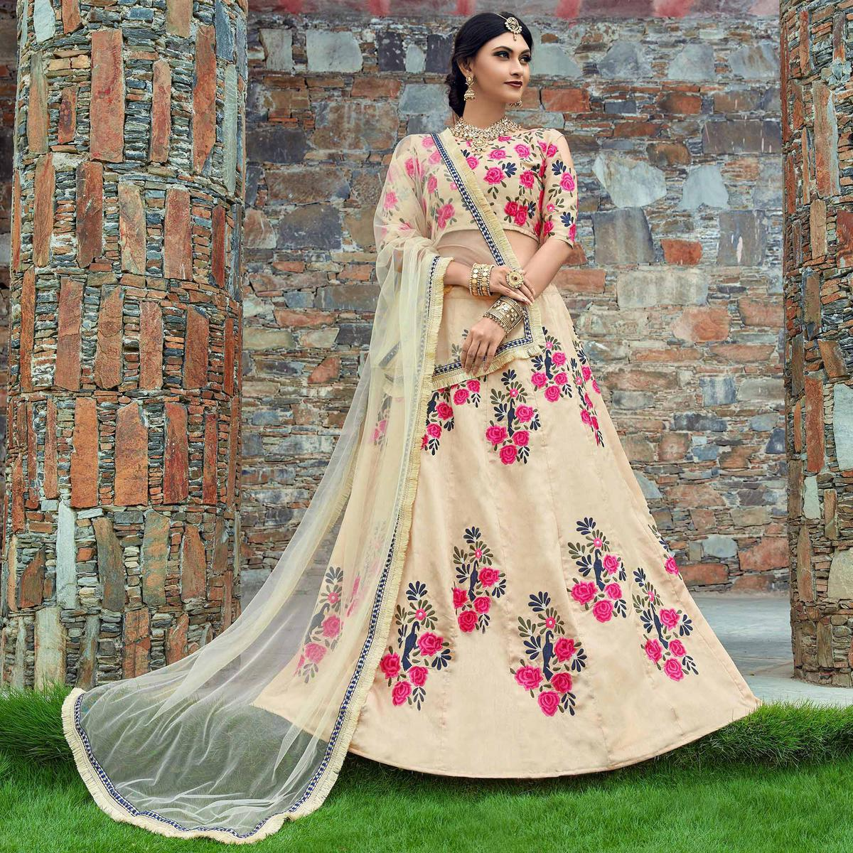 Appealing Cream Colored Wedding Wear Embroidered Art Silk Lehenga Choli