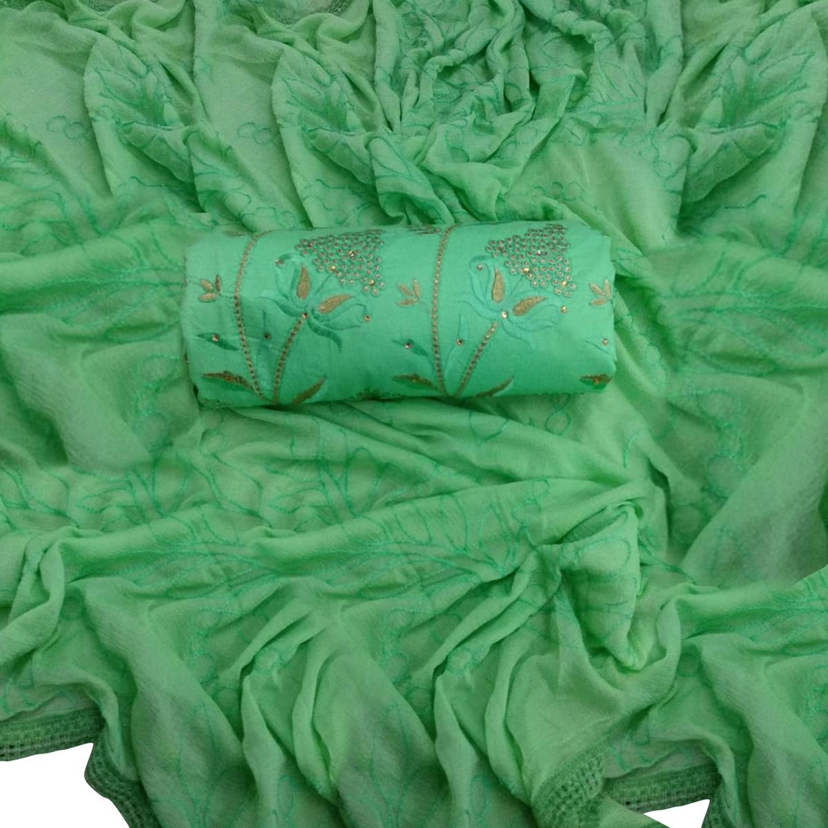 Innovative Green Colored Partywear Embroidered Cotton Dress Material