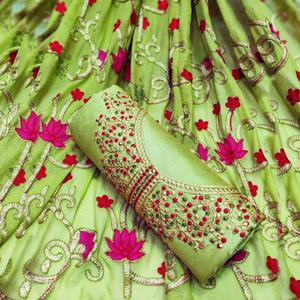 Eye-Catching Green Colored Partywear Embroidered Chanderi Silk Dress Material