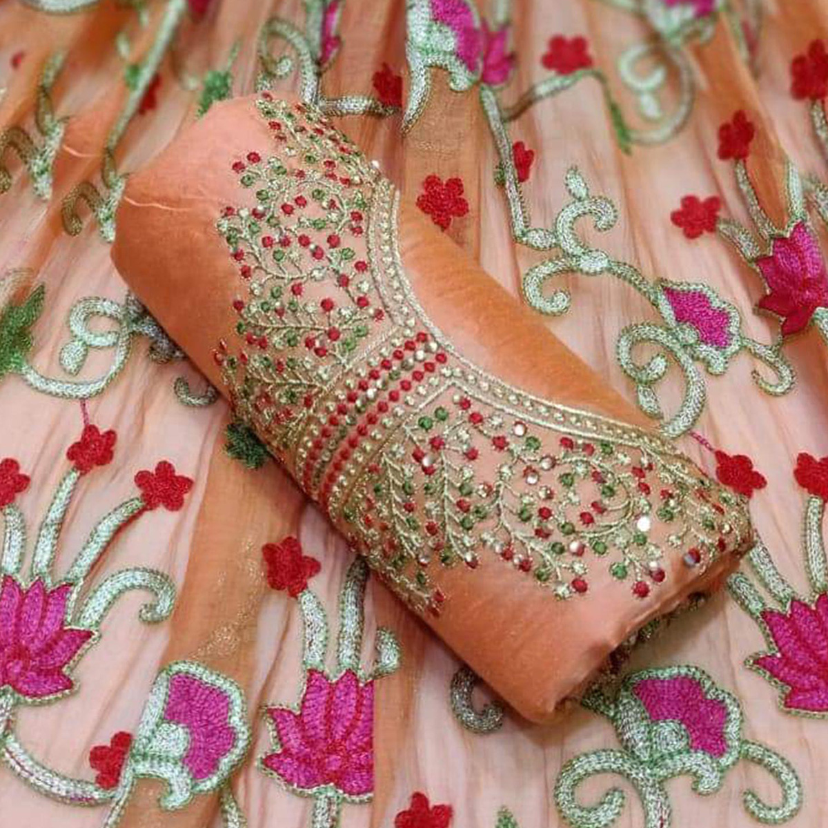Marvellous Peach Colored Partywear Embroidered Chanderi Silk Dress Material