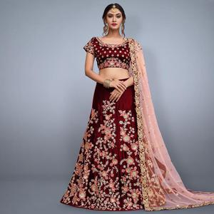 Radiant Maroon Colored Party Wear Embroidered Velvet Silk Lehenga Choli