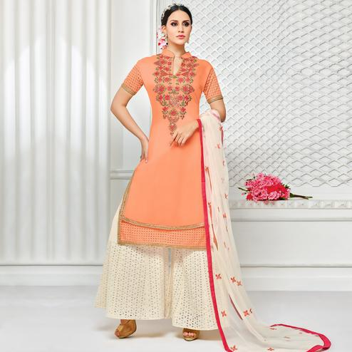 Hypnotic Peach Colored Partywear Embroidered Pure Cotton Silk Palazzo Suit