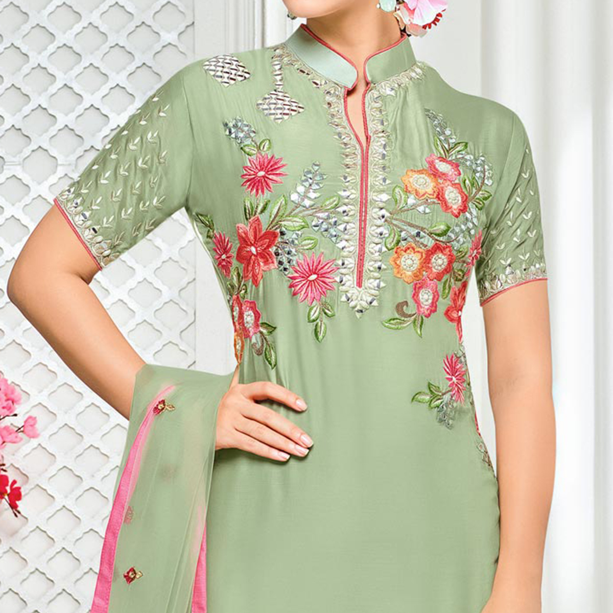 Gorgeous Light Green Colored Partywear Embroidered Pure Cotton Silk Palazzo Suit