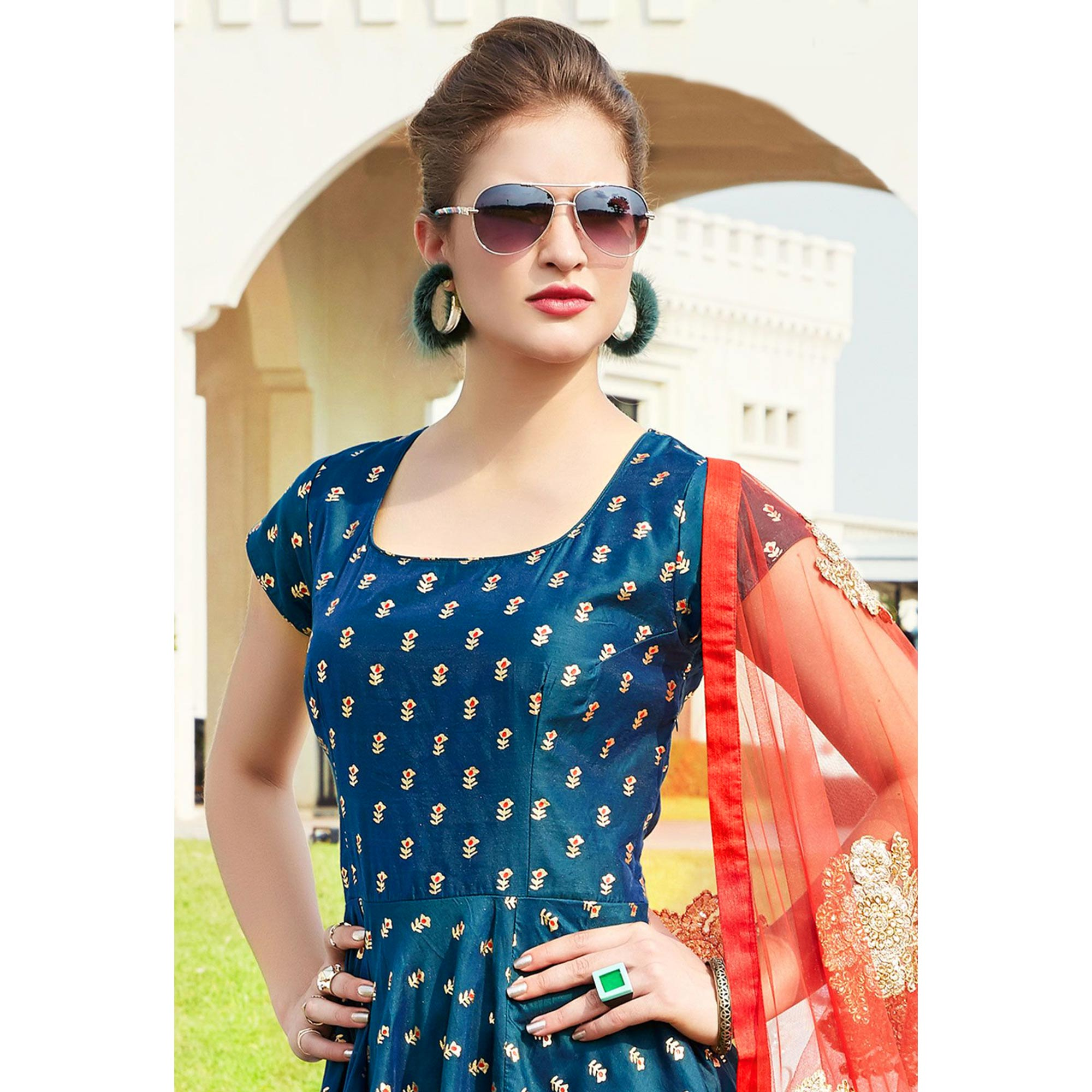 Stunning Teal Green Colored Party Wear Printed Tapetta Silk Anarkali Suit