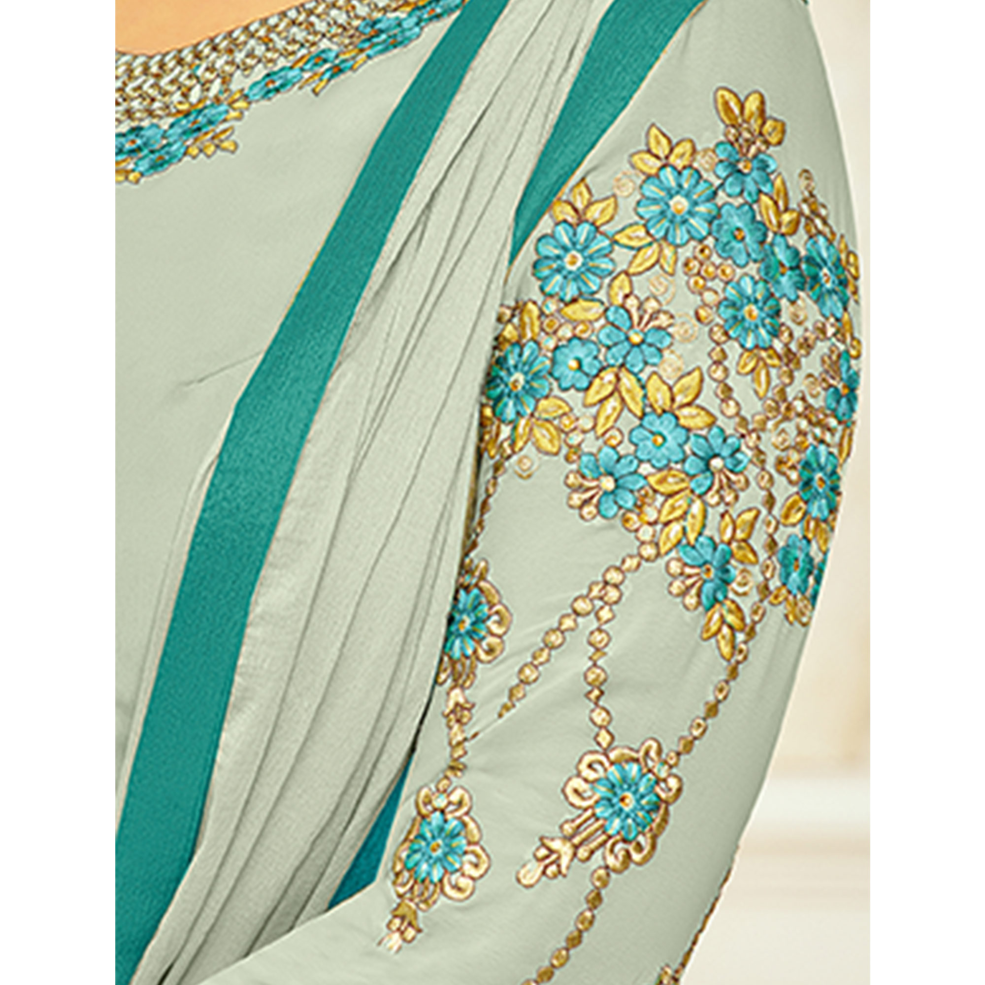 Impressive Light Aqua Green Colored Partywear Embroidered Georgette Suit