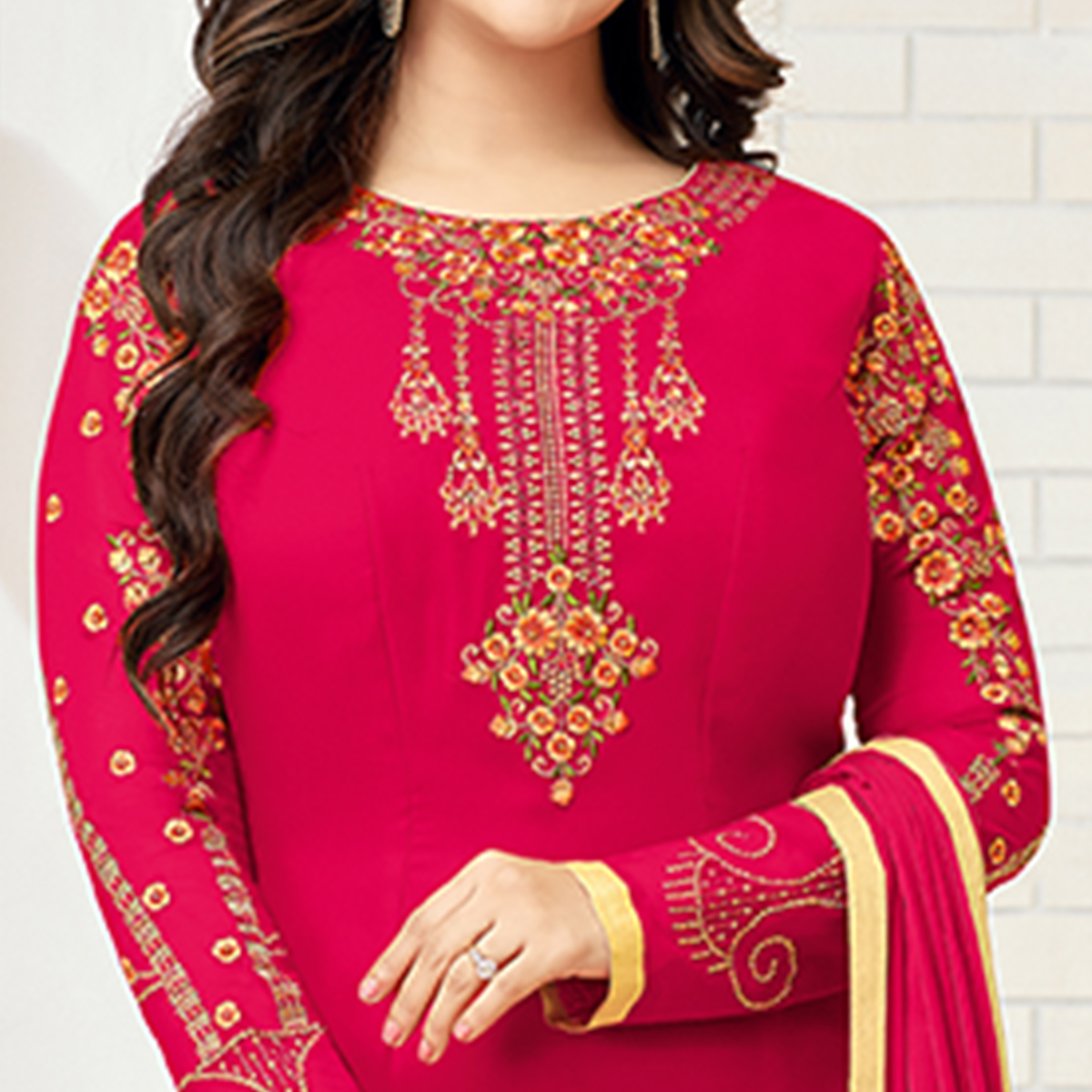 Unique Fuschia Pink Colored Partywear Embroidered Georgette Suit