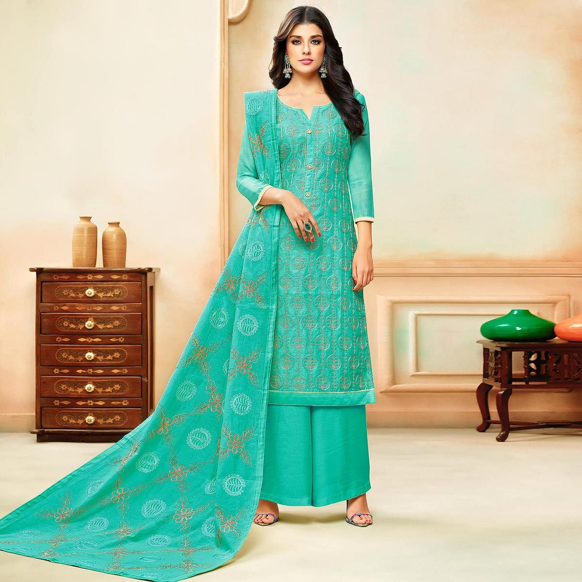 Eye-catching Turquoise Colored Party Wear Embroidered Modal Silk Palazzo Suit