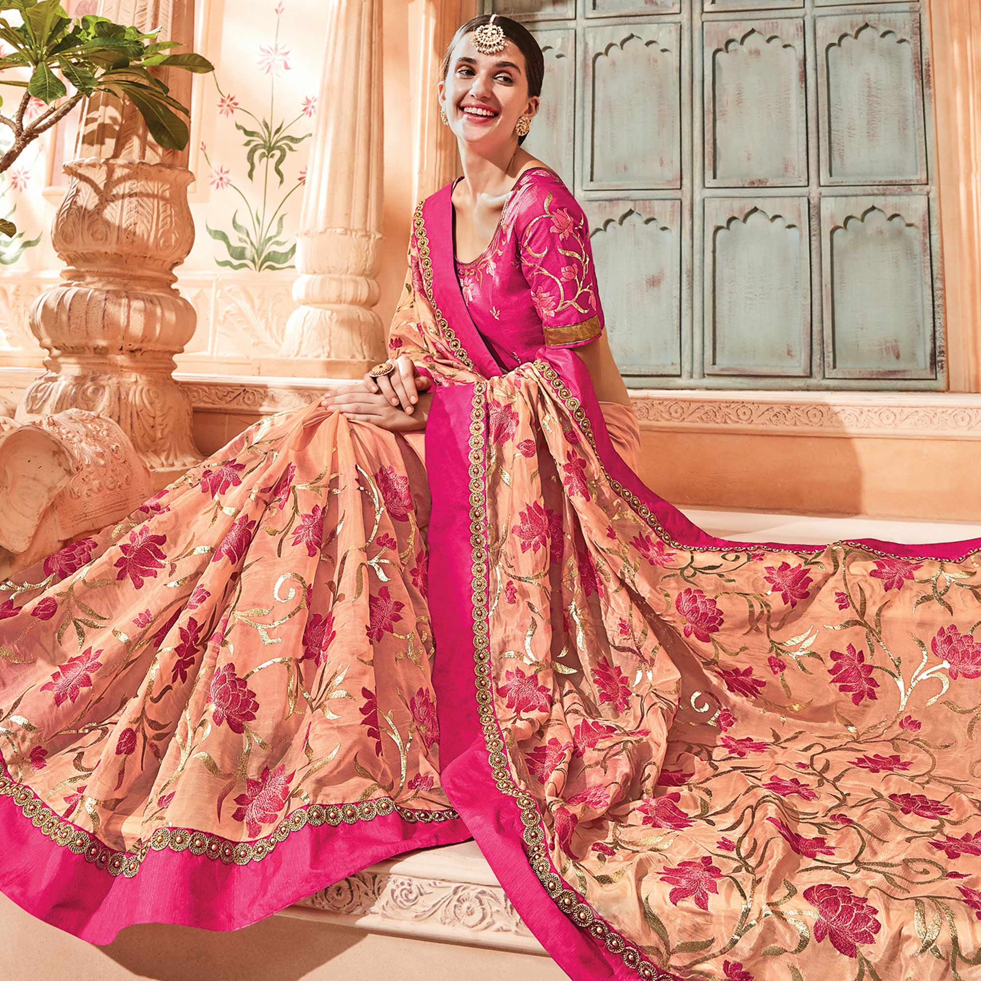 Elegant Peach Colored Embroidered Party Wear Art Silk Saree