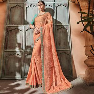 Radiant Peach Colored Embroidered Party Wear Georgette Saree