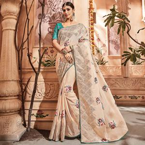 Breathtaking Cream Colored Embroidered Party Wear Art Silk Saree