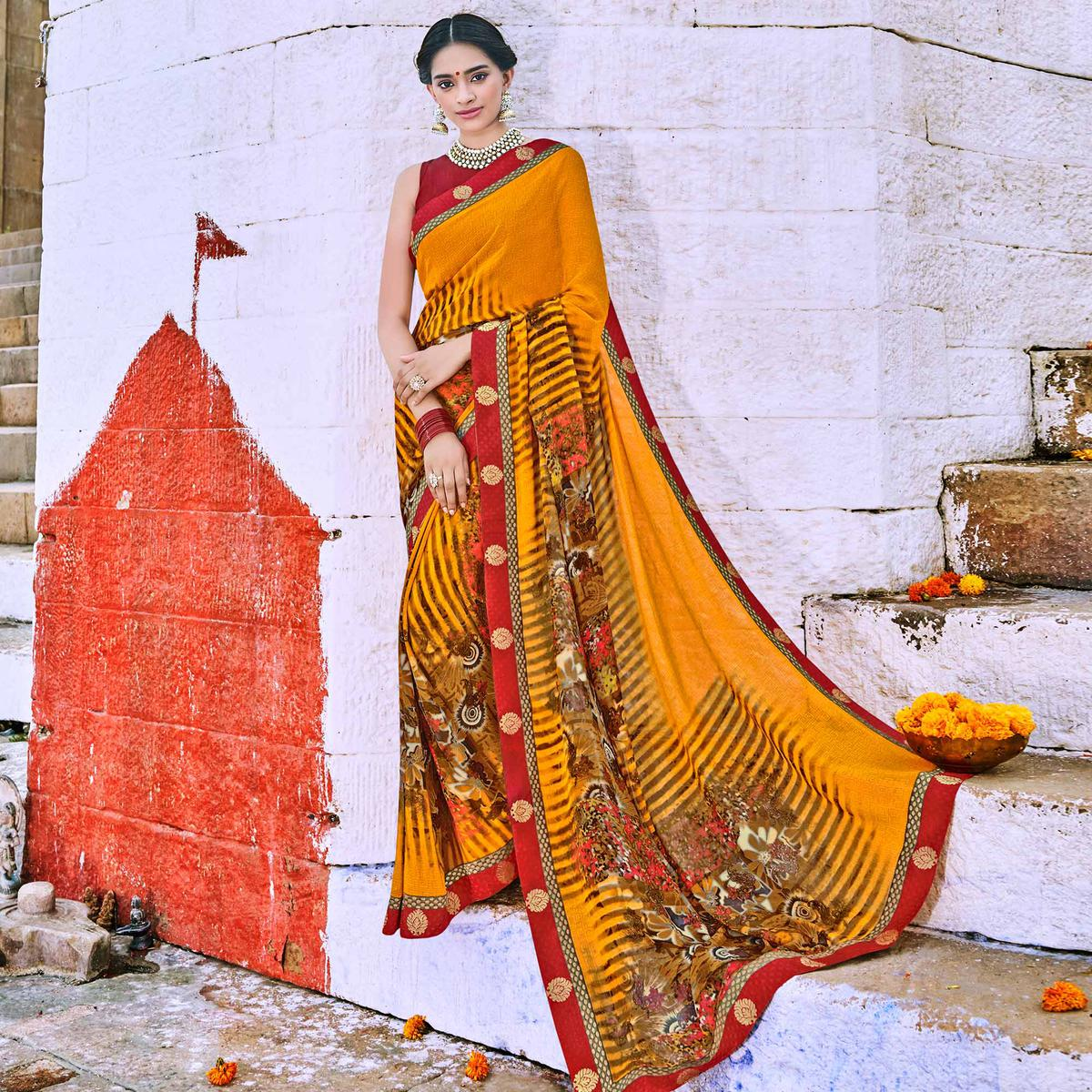 Opulent Mustard Yellow Colored Party Wear Printed Georgette Saree