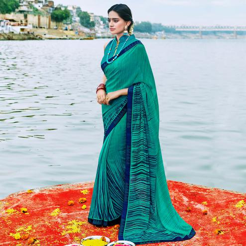Excellent Aqua Green Colored Party Wear Printed Georgette Saree