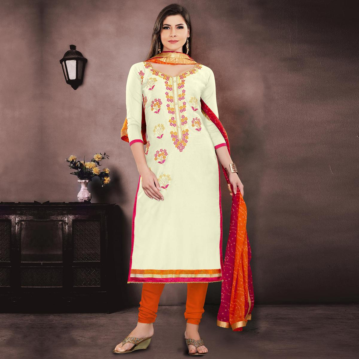 Glowing Cream Colored Embroidered Partywear Chanderi Silk Dress Material