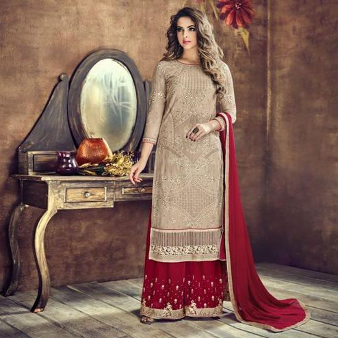 Gorgeous Beige Colored Party Wear Embroidered Heavy Net Palazzo Suit