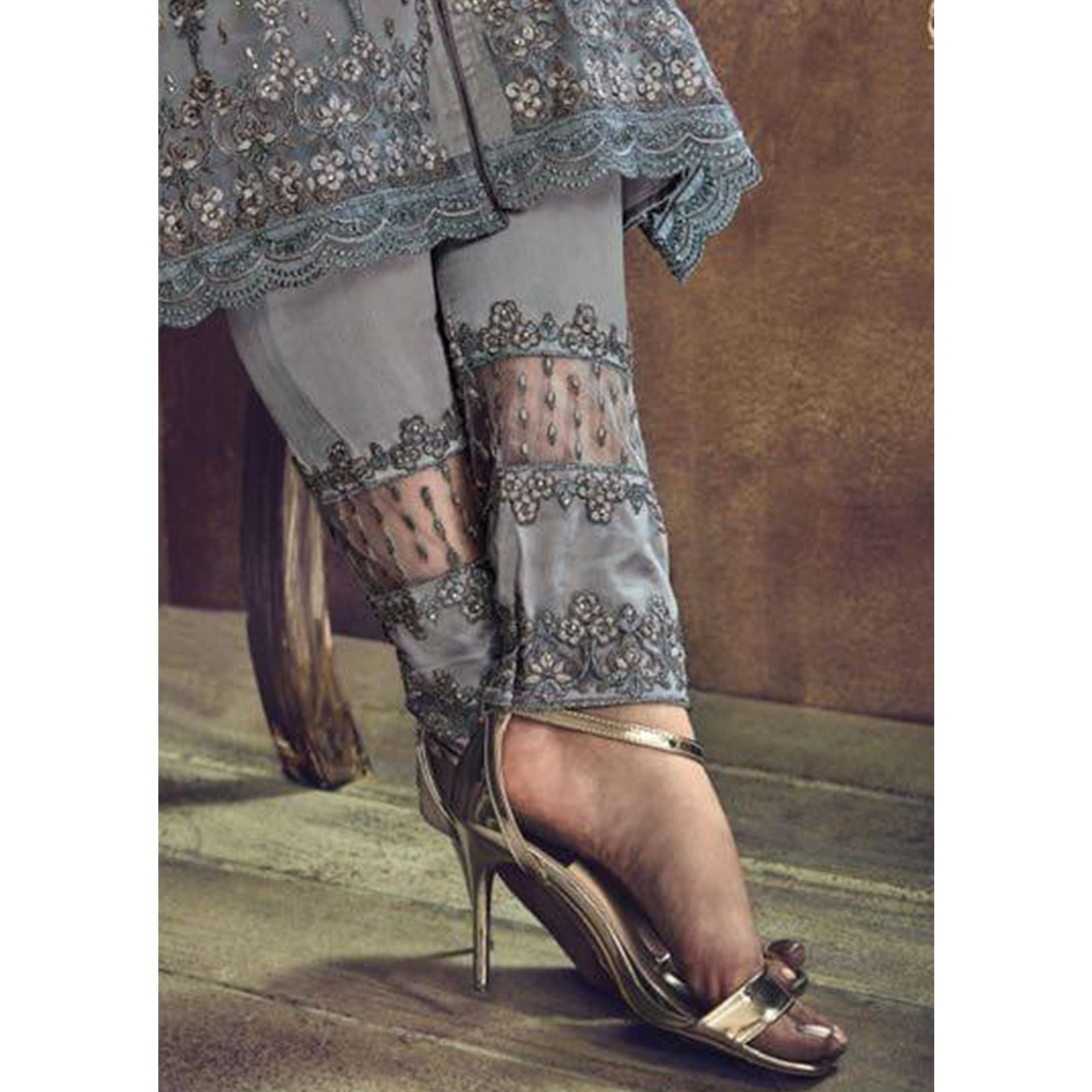 Graceful Dark Grey Colored Party Wear Embroidered Heavy Net Suit