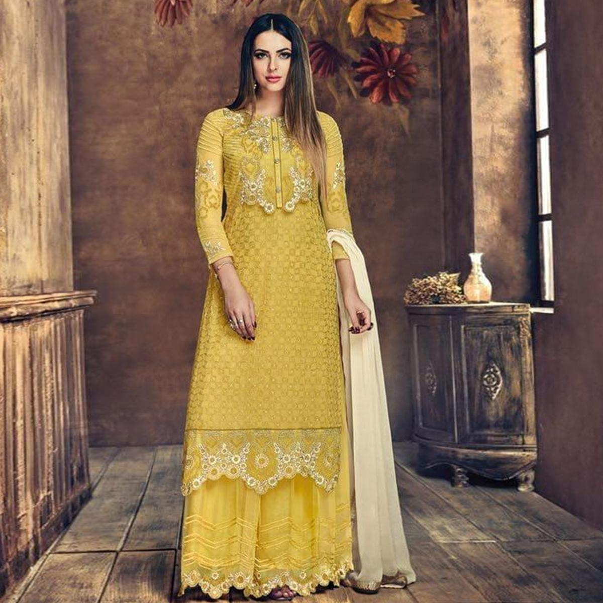 Lovely Yellow Colored Party Wear Embroidered Georgette Palazzo Suit