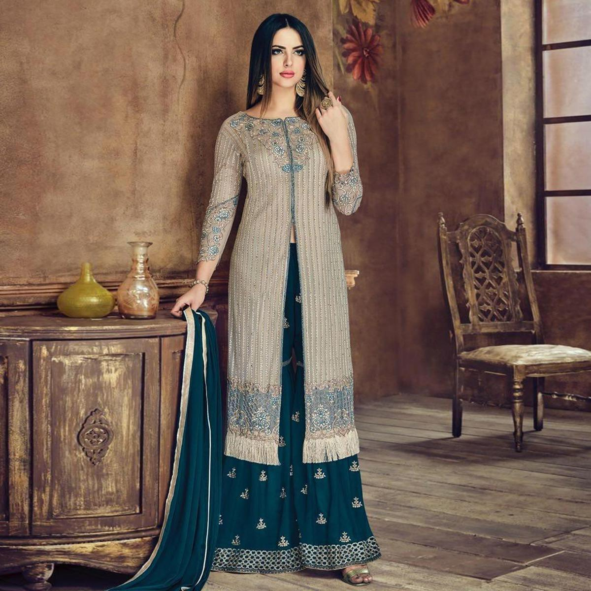 Ravishing Grey Colored Party Wear Embroidered Heavy Net Palazzo Suit