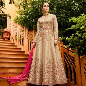 Appealing Beige Colored Partywear Embroidered Silk Anarkali Suit