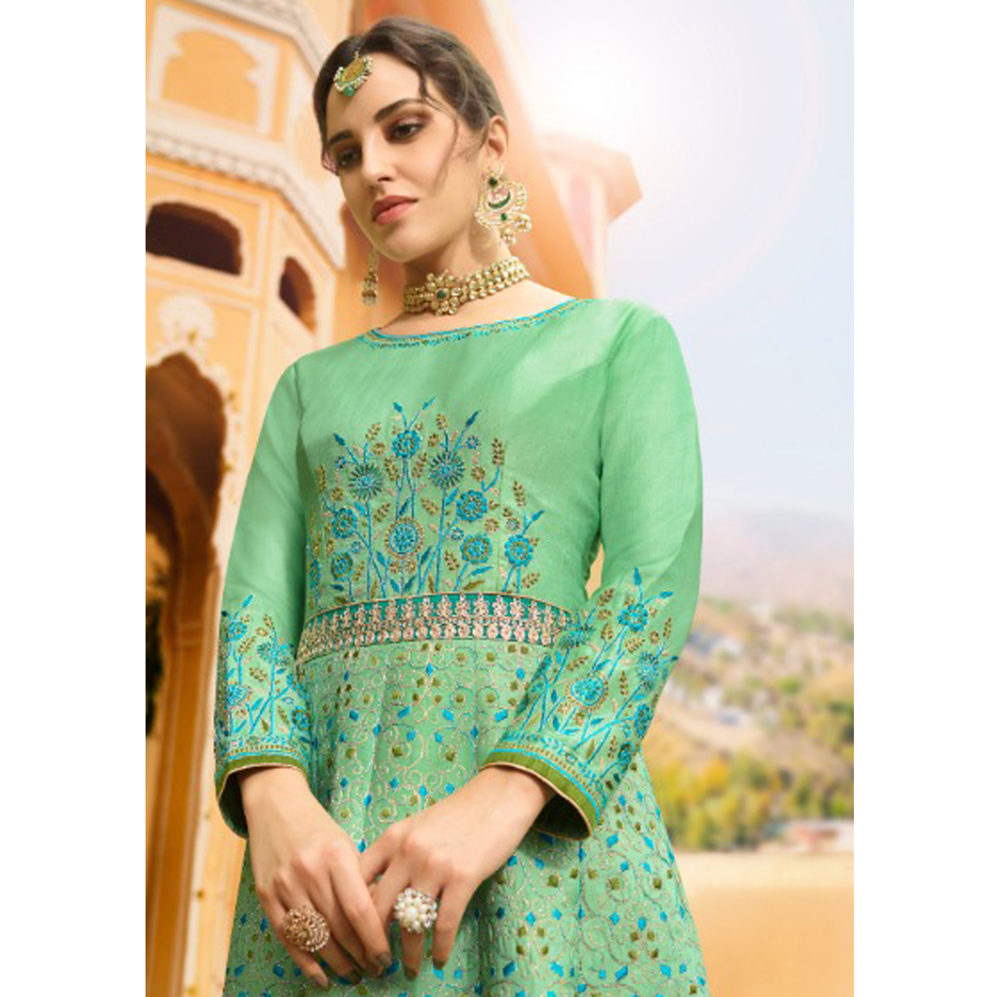 Glowing Turquoise Green Colored Partywear Embroidered Silk Anarkali Suit