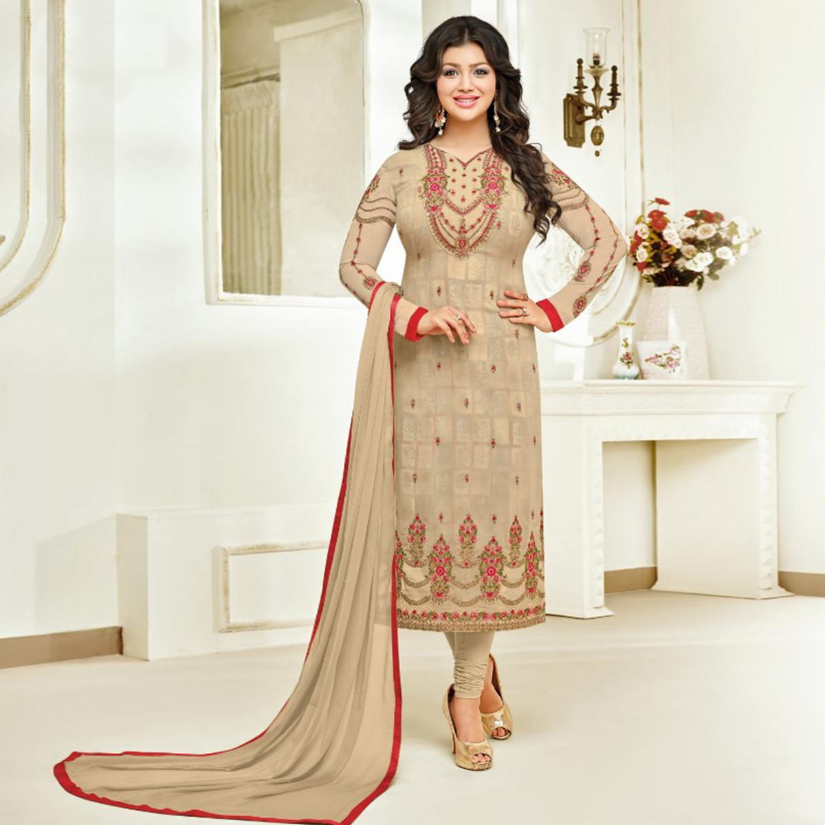 Appealing Beige Colored Partywear Embroidered Faux Georgette Suit