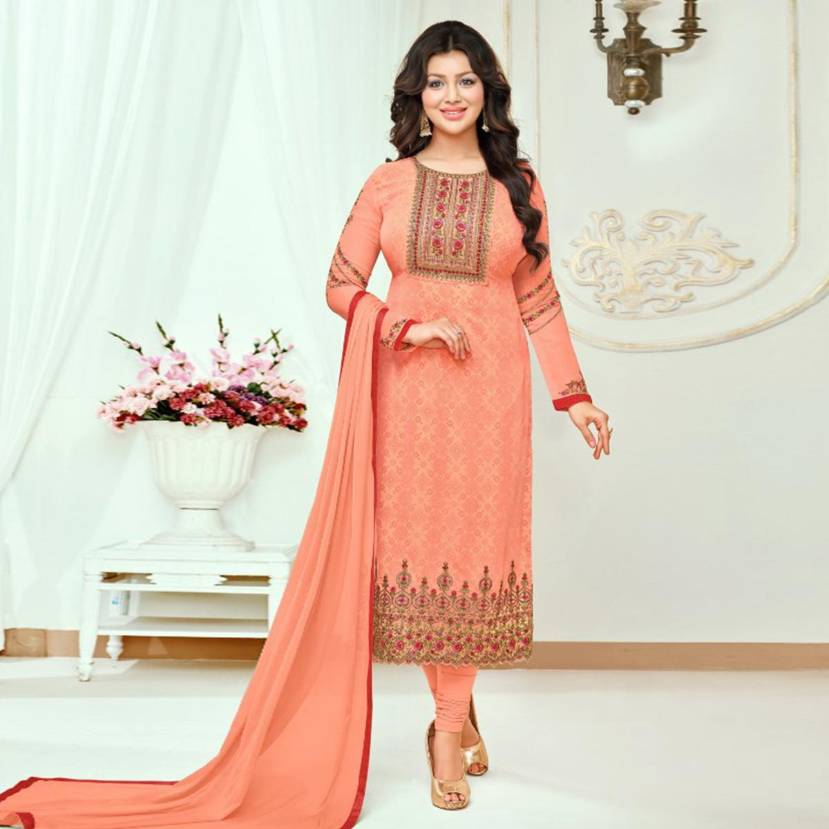 Gorgeous Peach Colored Partywear Embroidered Faux Georgette Suit