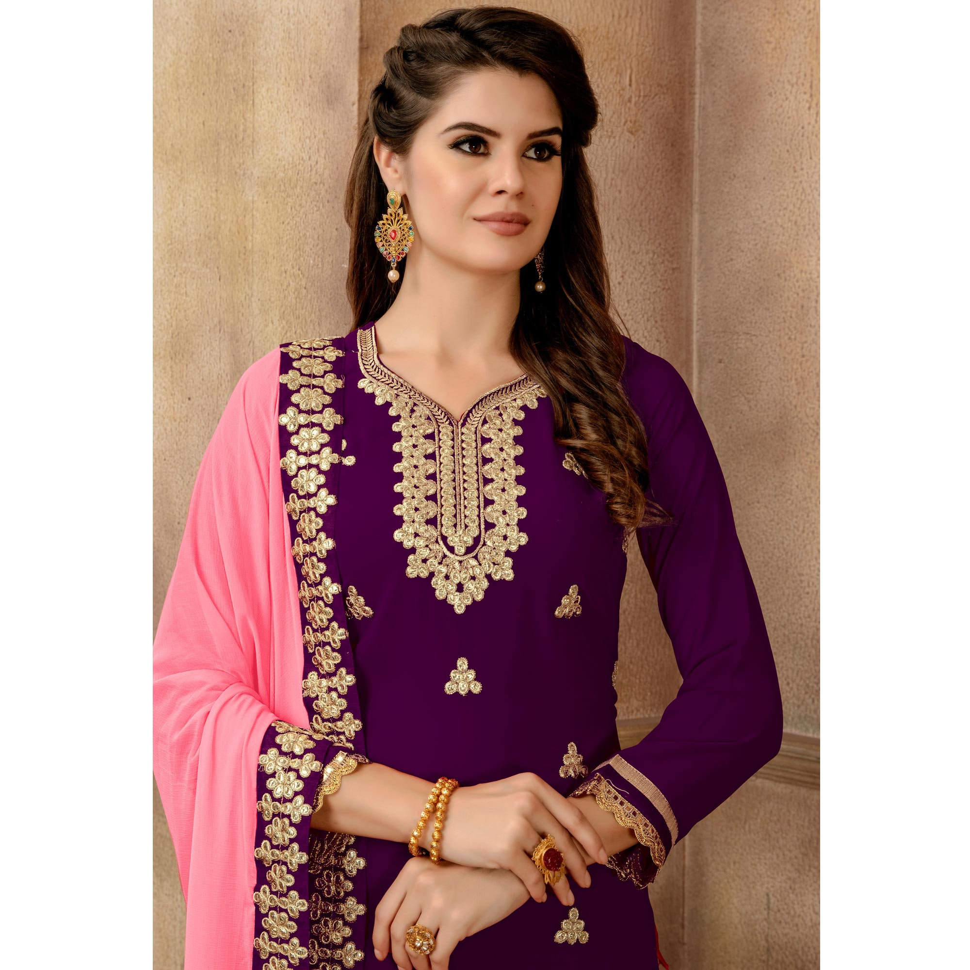 Hypnotic Purple Colored Partywear Embroidered Faux Georgette Palazzo Suit