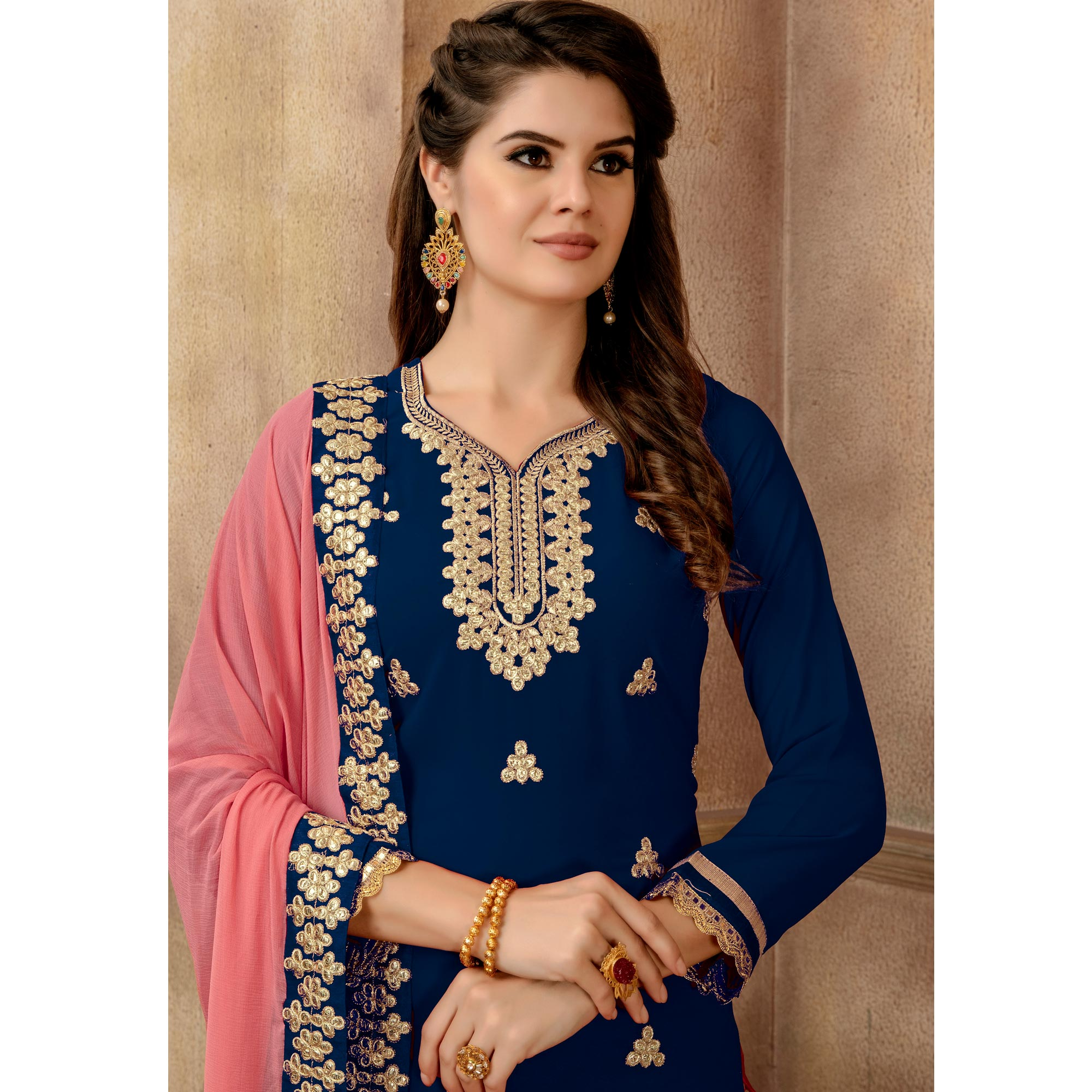 Desirable Blue Colored Partywear Embroidered Faux Georgette Palazzo Suit