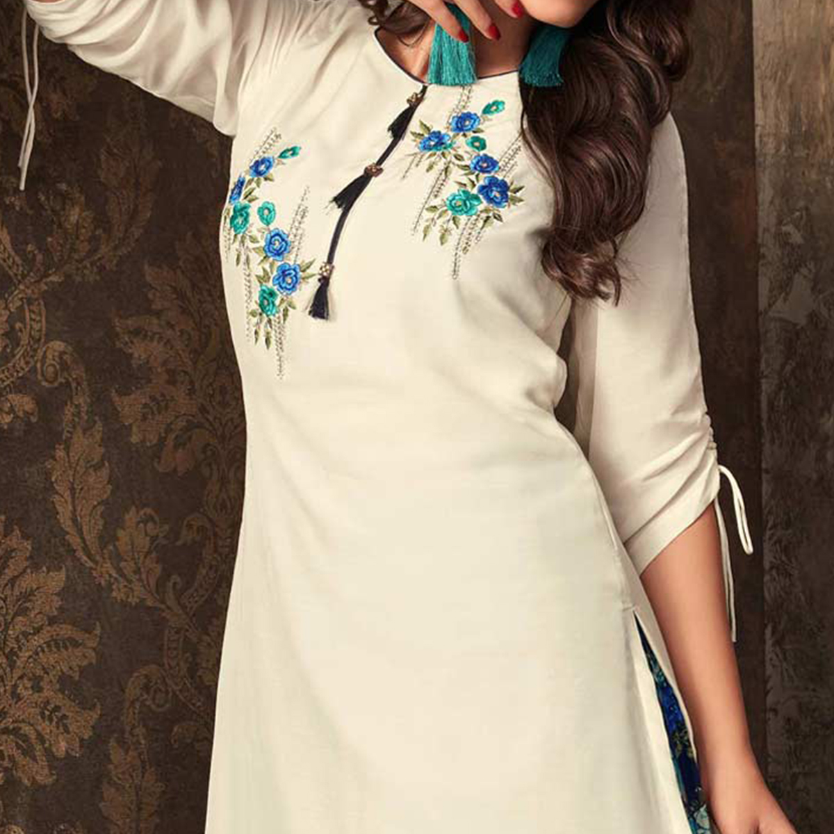 Eye-Catching White Colored Partywear Embroidered Kurti & Skirt Set