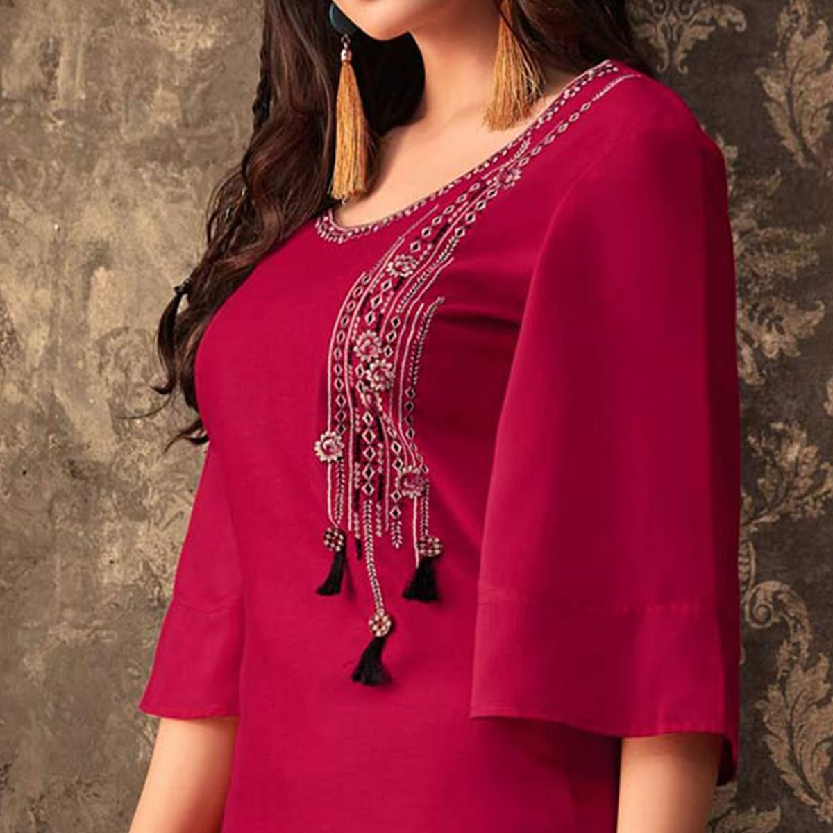 Jazzy Magenta Pink Colored Partywear Embroidered Kurti & Skirt Set