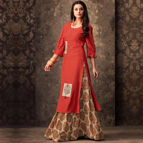 Flattering Orange Colored Partywear Embroidered Kurti & Skirt Set