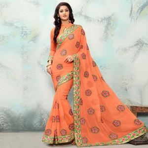 Demanding Peach Colored Partywear Embroidered Georgette Saree