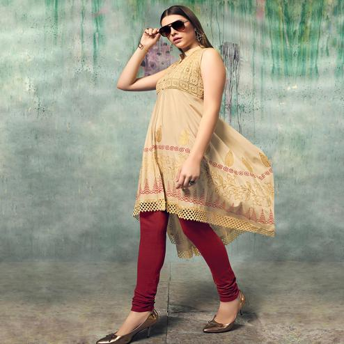 Refreshing Beige Colored Party Wear Embroidered Rayon Kurti