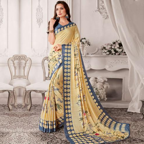 Graceful Cream Colored Casual Printed Georgette Saree