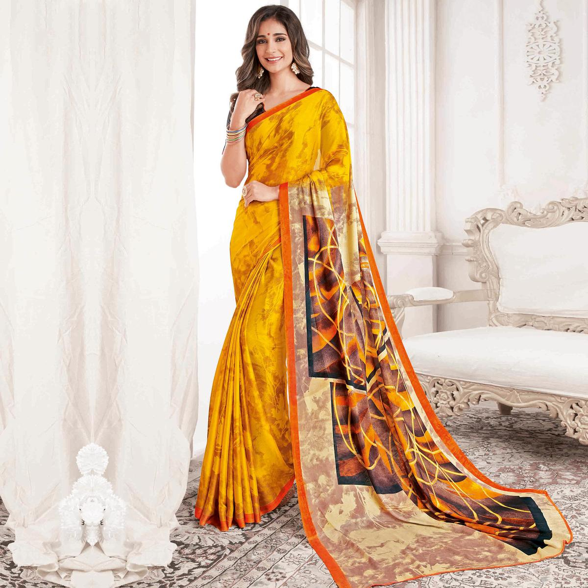 Gleaming Yellow Colored Casual Printed Georgette Saree