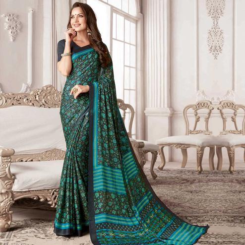 Imposing Black-Turquoise Blue Colored Casual Printed Georgette Saree