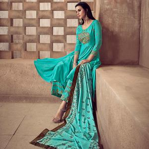 Jazzy Turquoise Colored Party Wear Embroidered Heavy Muslin Palazzo Suit