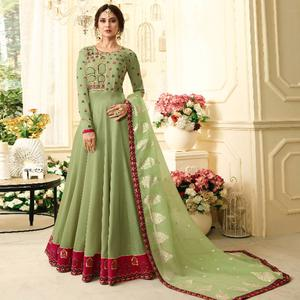 Alluring Pale Green Colored Partywear Embroidered Silk Anarkali Suit